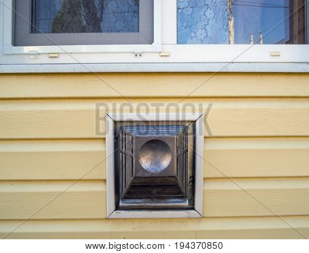 The output of the coaxial flue gas convector on the wall of the house