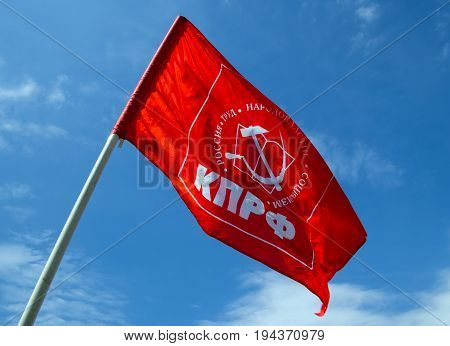 Voronezh, Russia - May 01, 2017: Flag of the Communist Party of Russia against the blue sky