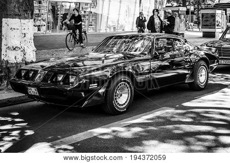 BERLIN - JUNE 17 2017: Muscle car Pontiac Firebird Turbo Trans Am (second generation). Black and white. Classic Days Berlin 2017.