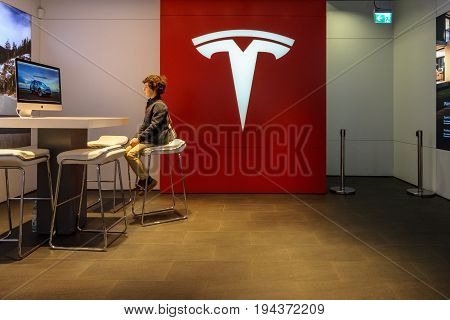 BERLIN - JUNE 17; 2017: Showroom Tesla Motors on the Kurfuerstendamm. Tesla Inc. is an American automaker energy storage company and solar panel manufacturer.