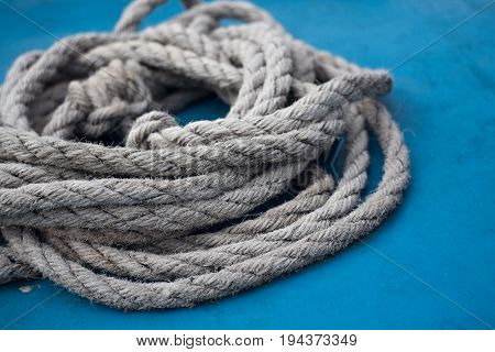 closeup photo of a piece of rope on a blue boat