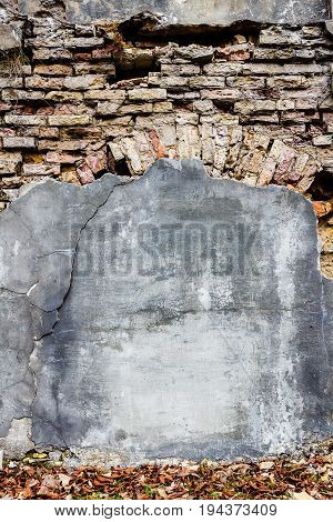 Background of cracked brick and plaster wall texture. Abandoned exterior urban background for your concept