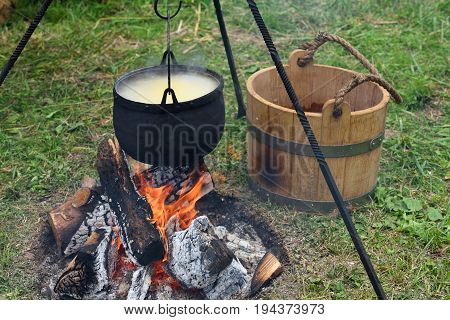 Cooking on the fire for a camping trip. Pot over a fire.