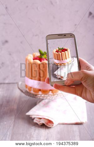 Taking photo of charlotte cake with smart phone