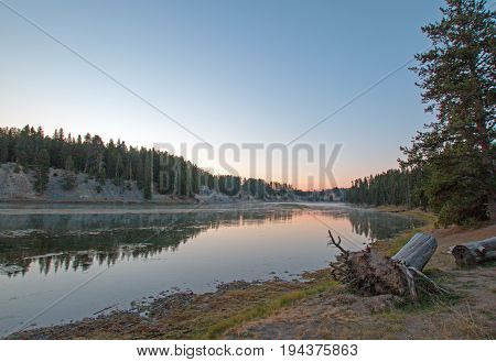 Sunset at Otter Creek with dead tree stump at Yellowstone River in Yellowstone National Park in Wyoming USA