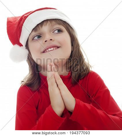 a little girl with a santa cap plead about gift