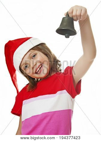 little girl with christmas bell isolated on white background