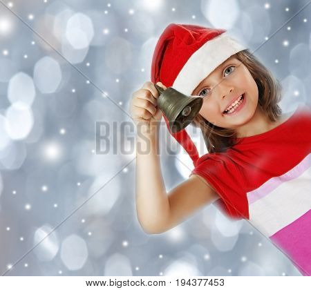little girl with christmas bell - snowfall background