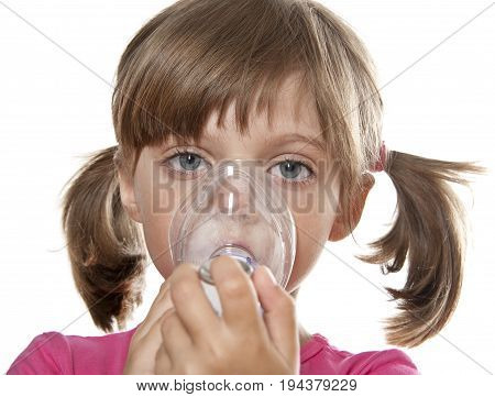 little girl using inhaler - respiratory problems