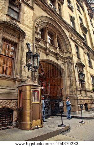 New York NY USA - October 9 2012: View of the Dakota building in New York in Upper West side where John Lennon and Yoko Ono lived at the time of Lennon`s murder in 1980. J. Lennon was killed just at the entrance arch.