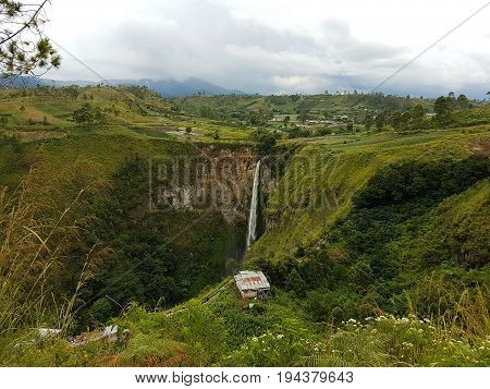 A beautiful Sipisopiso waterfall viewed from far