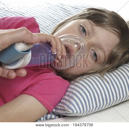 little girl with inhaler - respiratory problems for asthma
