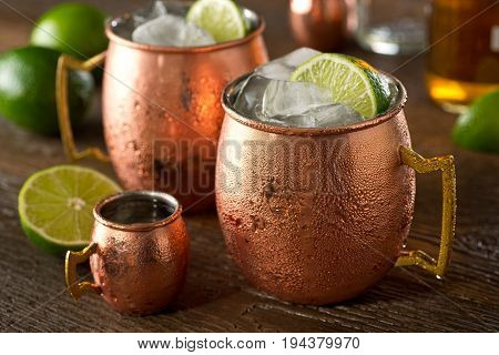 A delicious moscow mule cocktail with vodka ginger beer lime juice and ice.