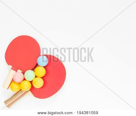 Sport background. Red ping-pong rackets and balls. Flat lay top view