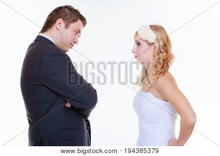 Relationship problems and troubles concept. Groom and bride having quarrel argument.