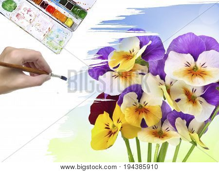 a hand is painting a picture on white background