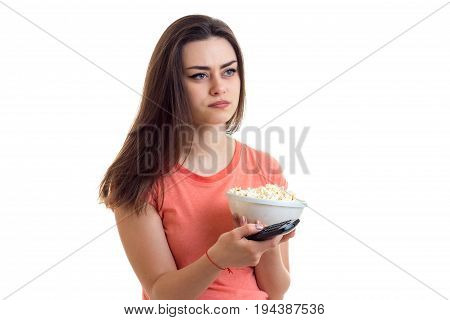 cute girl holds a plate with pop-corn is isolated on a white background