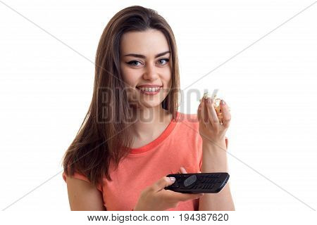 smiling charming lady with remote control in hand, and pop-corn is isolated on a white background close-up