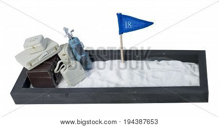 Suitcases and Golf Clubs and Flag in an Enclosed Sand Pit - Path included