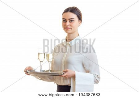 beautiful skinny waitress with glasses of wine isolated on white background