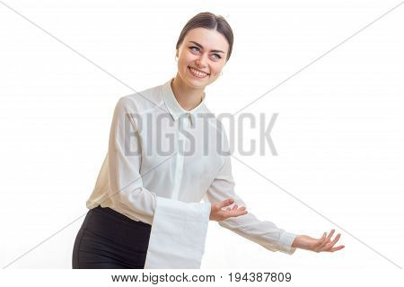 smiling charming waitress with a napkin on the table offers hand isolated on white background