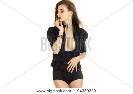 sexy sensual girl in black dress with nude large breasts posing on camera isolated on white background