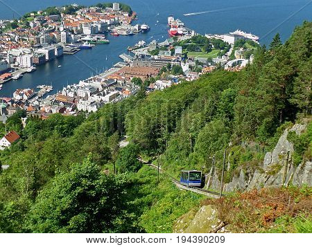 Impressive Bergen's harbor view and the funicular or Floibanen heading to the top of Mount Floyen, Bergen, Norway
