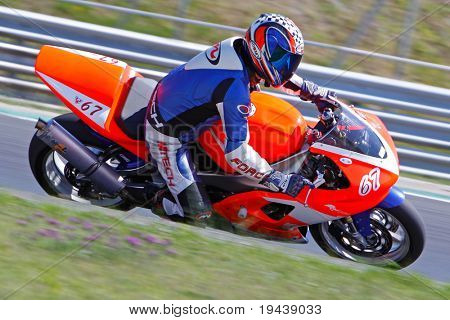 HUNGARORING, HUNGARY - JUNE 19: An unidentified rider negotiates a corner during ROSBK event at Hungaroring Race Track on June 19,  2009 in Hungaroring, Hungary.