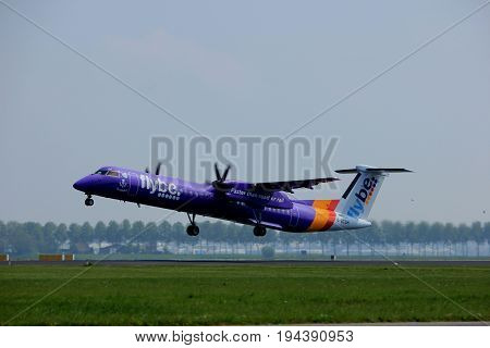 Amsterdam the Netherlands - May 6th 2017: G-ECOH Flybe De Havilland Canada DHC-8-402Q Dash 8 takeoff from Polderbaan runway Amsterdam Schiphol Airport