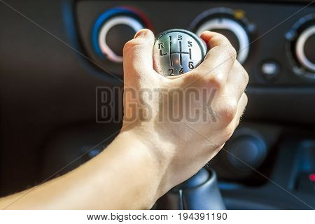Driver hand shifting gear shift knob manually selective focus