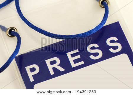 Blue Press Pass ID Card close-up isolated