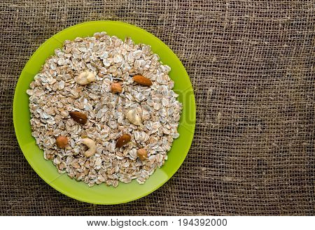 Muesli With Nuts  (hazelnuts, Cashews, Almonds). Muesli On A Wooden Table. Muesli Top View . Healthy