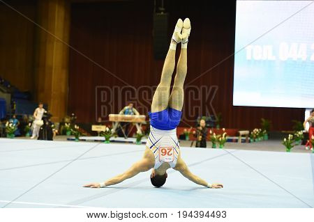 Kyiv. Ukraine-April 1, 2017 : Male gymnast performing on stationary  during Stella Zakharova Artistic Gymnastics Cup