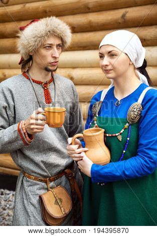 Khabarovsk Russia - June 11 2017: Young couple wearing medieval period costumes. Man and woman in middle ages peasant clothing at historic reenactment