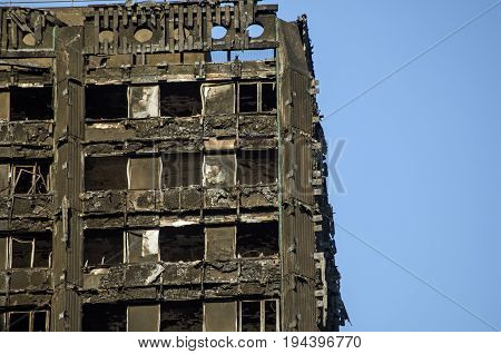 LONDON UK - JULY 5 2017: Part of the top floors of the Grenfell Tower block of council flats in which at least 80 people are thought to have been killed following a fire in Kensington West London.