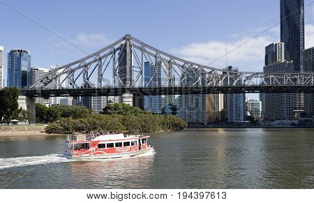 BRISBANE, AUSTRALIA - June 22, 2017: The Story Bridge is the longest cantilever bridge in Australia and spans 777 m over the Brisbane River. A ferry on a daily tourist trip.