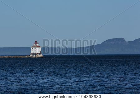Thunder Bay Lighthouse on a breakwater on Lake Superior.