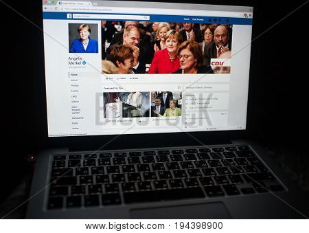 MOSCOW RUSSIA - July 09 2017 Official page in the social network Fasebook Federal Chancellor of Germany Angela Merkel on the laptop screen