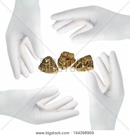 Four hands in gloves glove after a gold nugget in front of white background.
