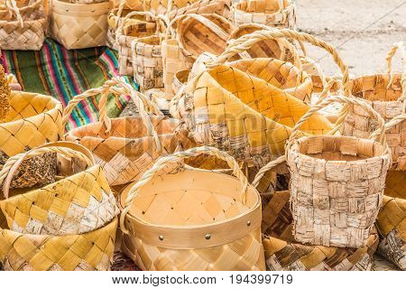 Many wicker baskets made from vines and birch bark with hands made