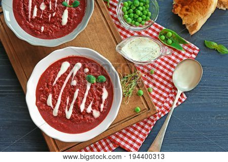 Delicious beet soup on kitchen table