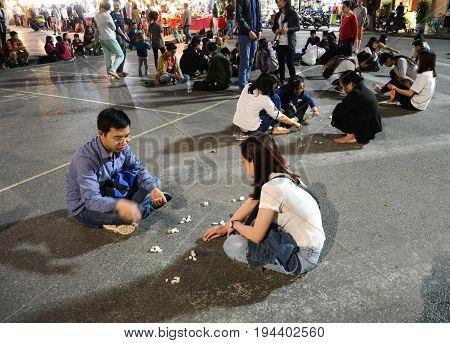 Hanoi Vietnam - Feb 19 2107 : folk games are played on the street by vietnamese at walking street around HoanKiem Lake in Hanoi Old Quarter( Pho co Hanoi)