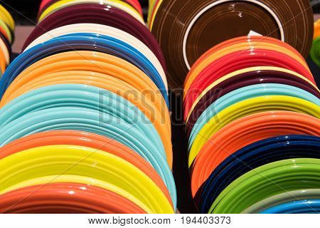 Colorful plates at an outdoor flea market