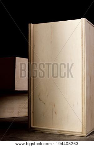 Light wooden boxes on a dark background