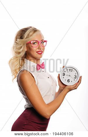 Young attractive girl in a blouse glasses and a bow tie is holding a watch. She appreciates her and your time. Fast service and support. Time is money