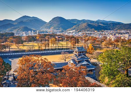 Kumamoto Castle Turret and the landscape of Kumamoto, Japan in autumn.