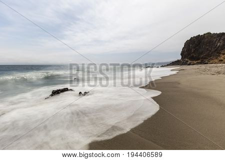 Secluded Pirates Cove Beach with motion blurred water at Point Dume State Park in Malibu, California.