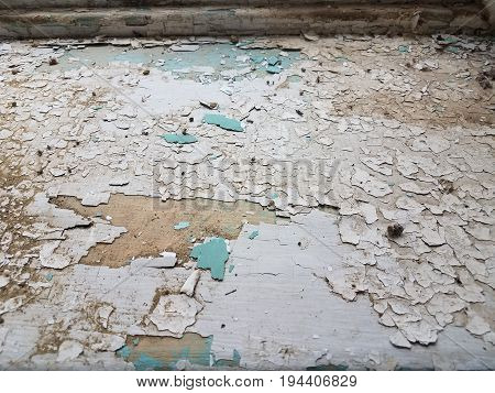 old dilapidated window sill with cracked and peeling paint