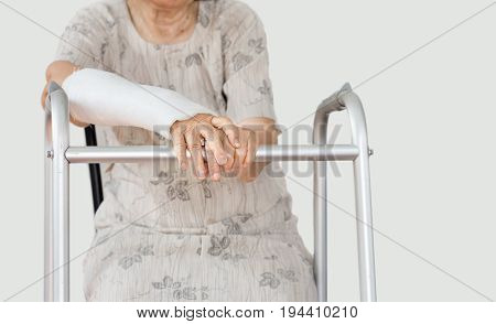 Senior women broken wrist using walker .