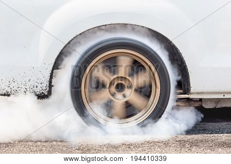 Dragster Car Burn Out Rear Tyres With Smoke .